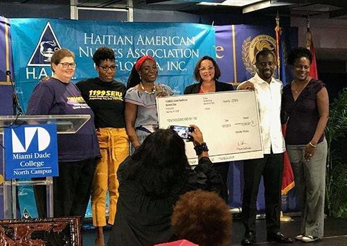 Bahamas Haitian Hurricane Relief 1199 staff Check Donation, Adobe Edited 500 x 300.jpg